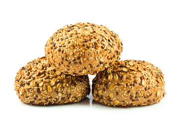 round wholemeal bread. resh buns with different seeds.