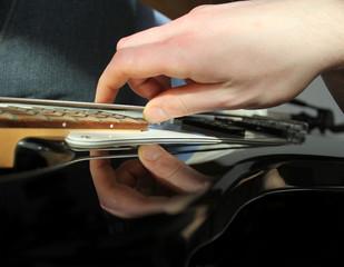 man playing electrical guitar