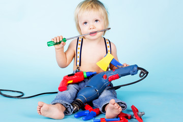 Little baby boy play with build tools