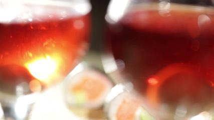 Sushi rolls and plum wine. Beautiful shallow dof.