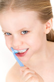 Child brushing teeth with toothpaste - smiling girl