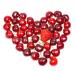 Heart from a sweet cherry on white background
