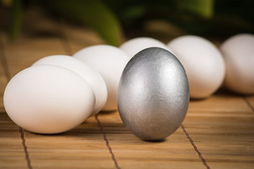 Silver Easter eggs on wooden background
