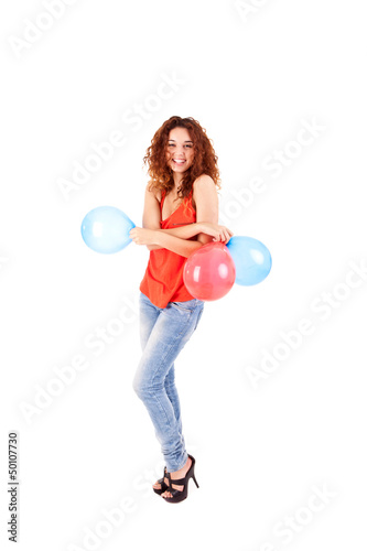 Happy beautiful woman holding balloons