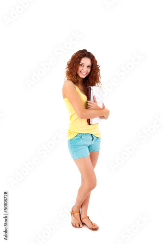 College girl holding books and smiling