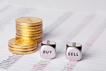 Chart, coins and dices cubes with words Sell Buy. Selective focu