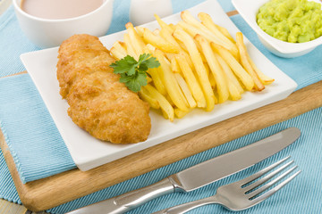 Fish & Chips - Battered cod fillet, chips, mushy peas & tea.