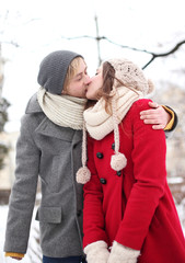 Couple kissing on winter day