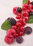 berries fruits on wood