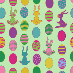 Seamless pattern with cartoon easter rabbit and eggs