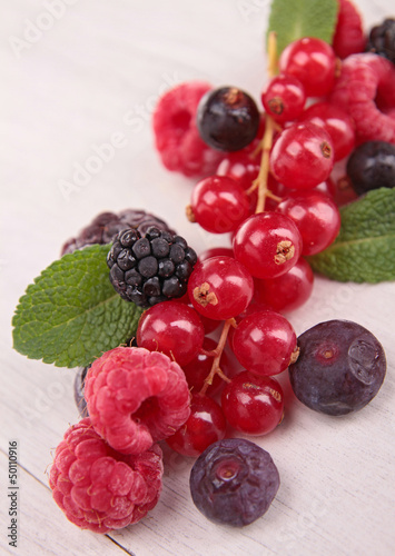 berries fruits on wood