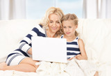 happy mother and child with laptop computer