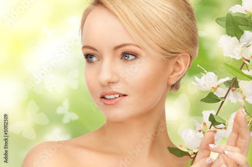 beautiful woman with flowers on twig
