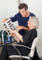 Client And Hairdresser Selecting Hair Color From Catalog