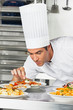 Male Chef Garnishing Pasta Dishes