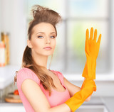 housewife with protective gloves