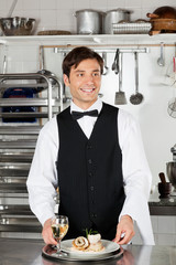 Waiter With Salmon Roll And White Wine