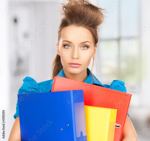 serious woman with folders