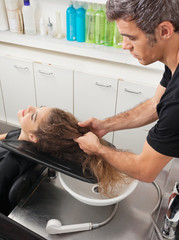 Hairstylist With Client Preparing For Hair Wash