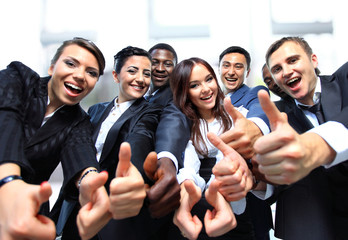 Successful business people with thumbs up