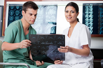 Medical Technicians Analyzing MRI X-ray