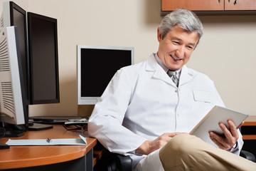 Happy Doctor Holding Digital Tablet