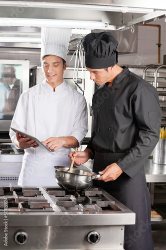 Young Chefs With Digital Tablet Preparing Food