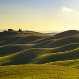 Tuscany, sunset rural landscape. Rolling hills and farm.