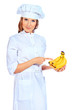 Smiling cook woman holding fresh banana.