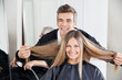Hairdresser Examining Customer's Hair St Salon