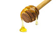 Honey dripping from a wooden of olives dipper