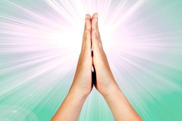 Hands clasped in prayer