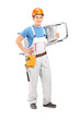 Full length portrait of a manual worker with a helmet carrying a
