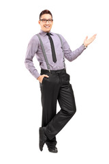Full length portrait of a stylish smiling male posing