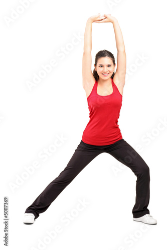 Full length portrait of a young female exercising