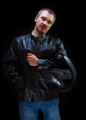 Adult motorcyclist in brown leather jacket.