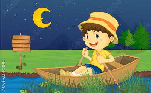 A boy riding in a boat