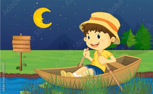 A boy riding in a boat