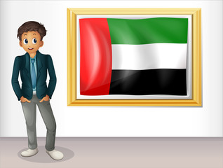 A gentleman beside a flag of United Arab Emirates