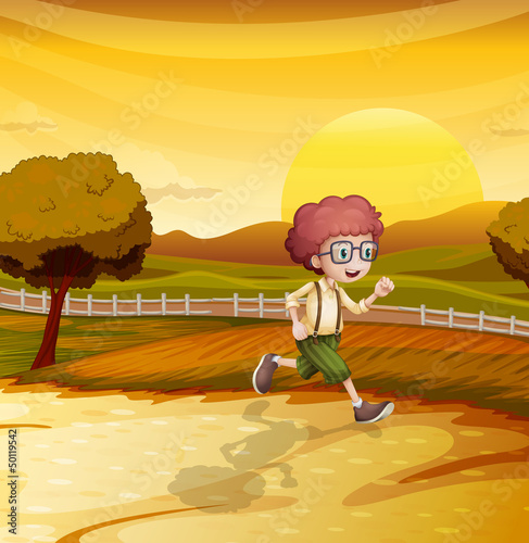 An afternoon view with a young boy running