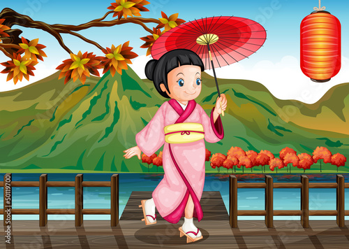 A lady wearing a pink kimono with an umbrella