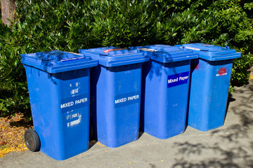 Row of Blue recycling bins
