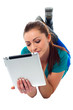 Relaxed young woman surfing on tablet device