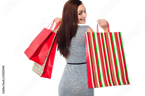 Young shopaholic female