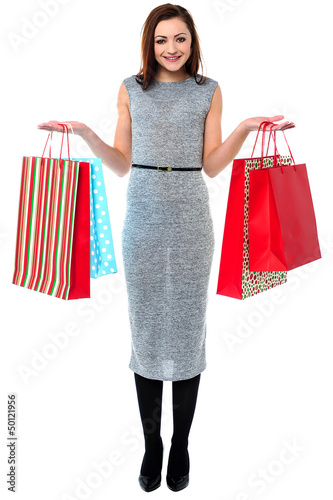 Portrait of a young shopaholic woman