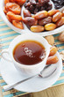 Cup Of Tea And Sweet Dried Fruits