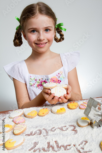 Happy Easter - lovely girl making easter cookies