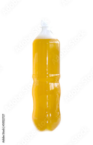 beer in a plastic bottle on a white background