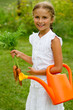 Gardening - lovely girl with bunch of carrots
