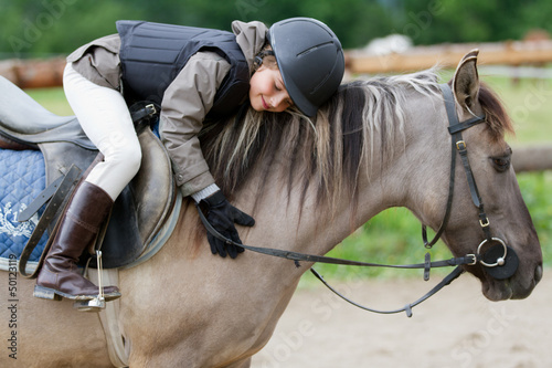 canvas print picture Horse riding - lovely equestrian on a horse